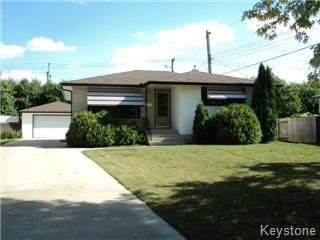 North Kildonan bungalow with a double detached garage.