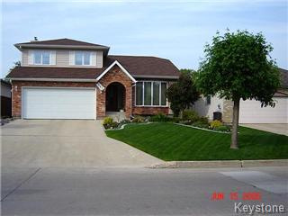 North Kildonan split-level with a double attached garage.