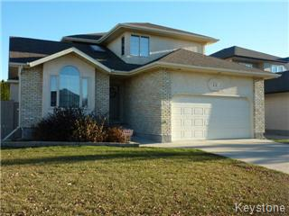 North Kildonan Two Storey with a double attached garage.